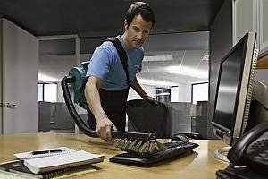 Providing Commercial Cleaning Services - Vacuuming a computer keyboard