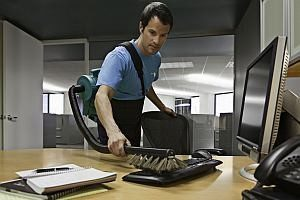 ServiceMaster ABC cleaning office desk and keyboard