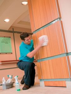 ServiceMaster Clean commercial cleaning professional washing down walls in an office building.